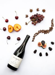 Flatlay Inspiration · via Custom Scene Wine bottle and fruit flatlay. Apartment 34 | What's Your Wine Profile? #VirtualLaCrema
