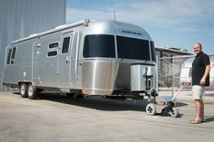 Most power tow dollies can connect to the latest Airstream travel trailers due to the location of the jack post. Trailer Dolly, Power Trailer, Toy Hauler Trailers, Airstream Travel Trailers, Parking Solutions, Retro Campers, Water Crafts, Recreational Vehicles, Screens