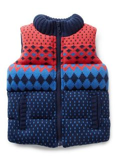 100% Cotton quilted vest with front pockets and rib collar. Features all over fairisle print and centre front zip opening.