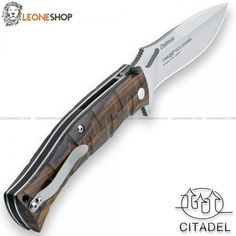 """Folding Military Tactical Knife Deimos CITADEL & FOX FKMD Italy, tactical military folding knives with serrated blade of N690Co Cobalt Vanadium stainless steel of high quality satin finished - HRC 58/60 - Blade lenght 4.5"""" - Thickness 0.16"""" - Handle made with two steel liners and Ziricote Wood inserts cnc machined for a better grip, a very elegant and precious tropical wood of dark brown color coming from Central America and Mexico - Liner Lock system, reversible back clip and Safety blade…"""