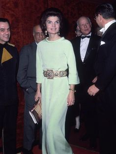A long water green silk evening Dress with a gold Belt by Givenchy