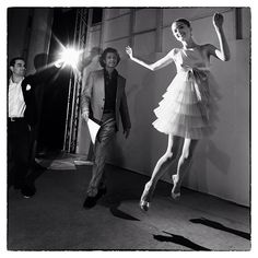 """A model takes flight upon exiting the catwalk at Paris fashion week.""- Photo by David Yoder"
