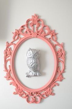 love this: cool ornate frame around sculptural item; use fresh colors to keep it looking modern