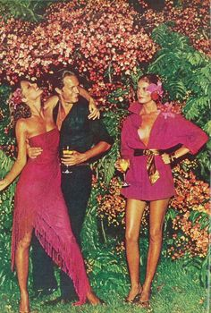 Renee Russo and Cheryl Tiegs by Helmut Newton Vogue 1974 // Flowers in hair and beautiful cerise pink dresses