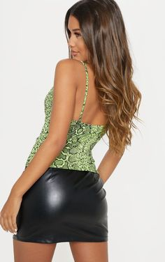 With a Neon Snake Printed Cowl Neck Cami Top, this is one very pretty lady looking sexy in a leather skirt. Black Leather Skirts, Leather Dresses, Sexy Outfits, Sexy Dresses, Looks Pinterest, Girls In Mini Skirts, Sexy Skirt, Cami Tops, Hot Dress