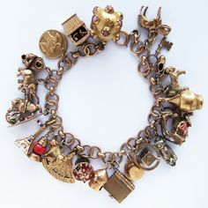 Traditional 1950s and 1960s Gold Charm Bracelet with Enamel and Mechanical Charms