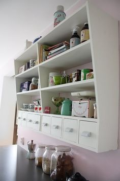 DO: love how these kitchen shelves are deeper on top than on the bottom.