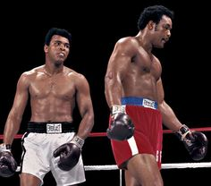 Ali stares at George Foreman during the Rumble in the Jungle. Ali earned his shot at the heavyweight... - Neil Leifer for Sports Illustrated