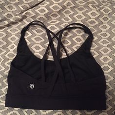 Black lululemon sports bra! Size 2 Black lululemon sports bra. Size 2! I have worn and washed this once. I received as a present and it's just too small on me! Tag no longer on sports bra but the washing requirements is the same as every lululemon product. Refer to their website for instructions. lululemon athletica Other