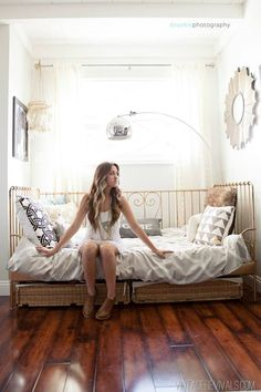 gold iron bed, white walls, white bedding
