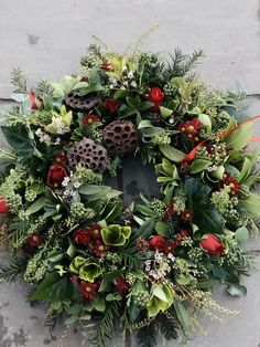 Christmas wreath using greenery foraged from the garden and shop bought roses. Christmas Door Wreaths, Christmas Flowers, Christmas Mood, Christmas Candles, Outdoor Christmas Decorations, Christmas Centerpieces, Holiday Wreaths, Christmas Themes, Flower Decorations