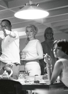 Marilyn Monroe and Frank Sinatra onboard Dean Martin's yacht photographed by Bernie Abramson, 1960.