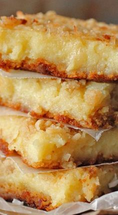 Lemon Coconut Gooey Bars are a delicious tropical dessert. These dessert bars are made with cake mix and cream cheese, so how could you go wrong? Lemon Desserts, Lemon Recipes, Just Desserts, Baking Recipes, Sweet Recipes, Cookie Recipes, Delicious Desserts, Yummy Food, Bar Recipes