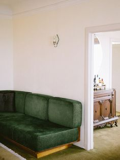 Green built-in sectional sofa in room 34 of Chateau Marmont Chateau Marmont, Built In Seating, Brown Carpet, Interior Inspiration, Travel Inspiration, Home Living Room, Sectional Sofa, Home Remodeling, House Design