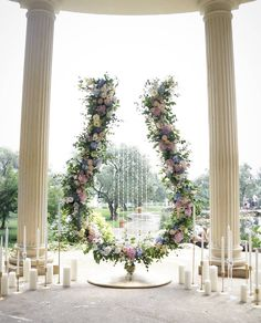 Wedding ceremony floral backdrop shaped like a giant lyre!