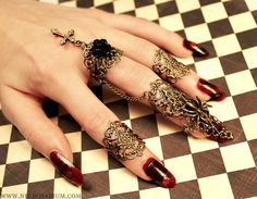 gothetsyfinds:  holliegoto:  Some of my Visual Kei claw style rings! :DI make these from pretty bronze filigree pieces and of course other metal findings! XDhttp://www.etsy.com/shop/Necrosarium  she is such a talented seller, I personaly suggest you check out her shop :)