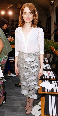 Emma Stone celebrated the CFDA Fashion Fund finalists in a white blouse (unbuttoned to create a plunging neckline) and a printed ruffled pencil skirt, all by Brock Collection. Jennifer Meyer jewelry, a chain-strap purse, and metallic sandals were the finishing touches.