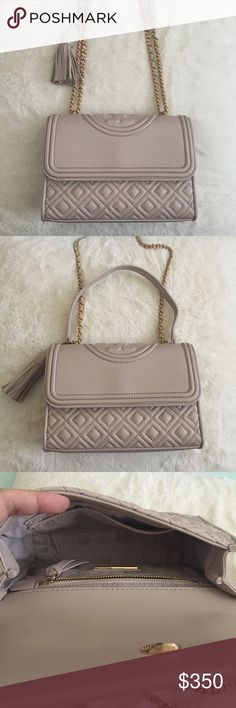 """Tory Burch Fleming Convertible Shoulder Bag New without tags. Color is Bedrock. Looks pretty and elegant. It comes with a dust bag. I just got this but I don't really need a new pink bag. I'm selling most of my bag collection. Please check out my other bags. Thank you!  Holds a mini wallet and an iPhone 6 Leather Flap with magnetic snap closure Leather-and-chain strap with 23.31"""" (58.5 cm) drop 1 exterior back pocket 2 interior slit pockets, 1 zipper pocket Removable tassel Height: 5.98"""" (15…"""