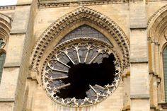 A picture taken on January 13, 2017 shows the broken stained glass rose window of the Gothic cathedral Saint-Gervais-et-Saint-Protais of Soissons, following an overnight storm. Strong winds in northern France cut power to some 190,000 homes as a storm surge sweeps Europe. François NASCIMBENI / AFP