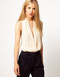 This blouse is a total must have - I have a similar one and it's a no brainer to throw on with just about any type of pant or skirt http://rstyle.me/n/ccr9rmnje
