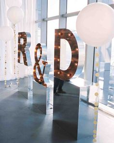Would love a modern penthouse engagement party where right outside there's a beach to party too! With my new last name lights