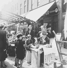"Licensure vs informal trades: ""This boy awaits treatment for a corn at the table of this makeshift foot clinic in Chapel Street. He would have paid a few pence for the cure."" Photo by Henry Grant, 1955 London Pictures, London Photos, Old Pictures, Old Photos, Vintage Photos, Retro Pictures, Vintage London, Old London, East London"