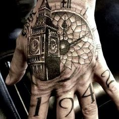Great black and grey Big Ben hand tattoo.