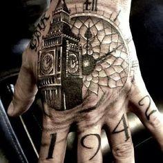 Great black and grey Big Ben hand tattoo.
