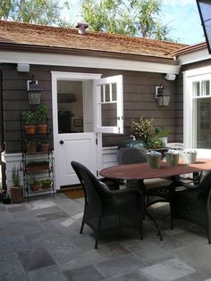 like it all...door, table and chairs (have), potted herb garden on shelves (ikea?), slate tile patio.