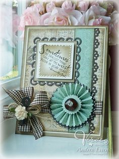 What a beautiful card! Love the aqua colors and the rosette