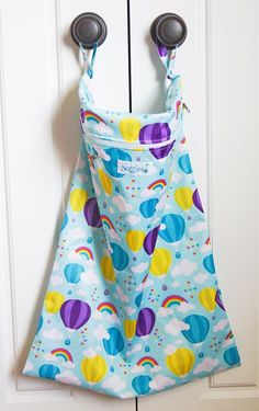 """Up & Away - Hanging Wet Bag - Nuggles Design Canada - #Clothdiapers   18"""" x 24"""", with two handles that unsnap, you can hang it anywhere! Link the two together for one sturdy handle! Can also be used to line a small pail.  Our nifty mesh-lined pouch allows you to put essential oils or a scented disc, or even carbon filter (just remember to remove before washing.) Holds approximately 15-20 diapers, OR dirty laundry, towels and swim suits, funky sports equipment .... the list goes on!"""