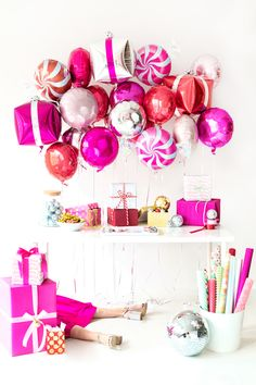 A Goodies + Gift Wrap Holiday Party (+ DIY Present Balloons!) Make DIY present balloons, peppermint balloons and a bar cart sleigh for your gift wrap party! Christmas Balloons, Pink Christmas, Christmas Wrapping, Christmas Colors, Merry Christmas, Balloon Garland, Balloon Decorations, Christmas Decorations, Candyland Decor