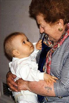 Holocaust survivor looking at her granddaughter.