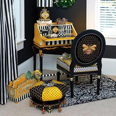Combine a little French flair with a bold yellow and black color palette, and you've got a piece that's fit for royalty. Made of hand-painted wood, our Worker Bee Writing Desk is buzzing with details like a pull-out tray and a flip-down front. While the lady of the house might not wear a crown, she'll enjoy a lounging in luxury when she places this collection in a sitting room, she-shed, or home office.  MacKenzie-Childs Worker Bee Writing Desk