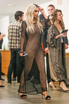 Kim Kardashian West in Copurs dress and Aquazurra shoes.