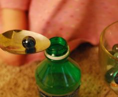 fine motor skills, marble, spoon, waterbottle - Re-pinned by #PediaStaff.  Visit http://ht.ly/63sNt for all our pediatric therapy pins