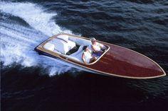 Beautiful V-Drive boat with Bubbinga deck and hardwood rails.  Miller Custom Boats