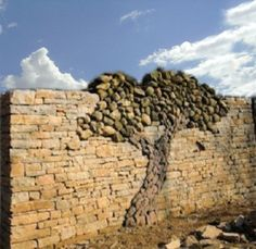 .stone tree shape in stacked stone wall