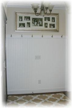 Add bead board and hooks to the space behind the door for a small entry way