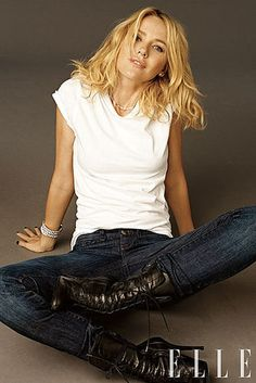 Naomi Watts strikes a casual pose in jeans and a classic white shirt
