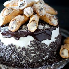 Cinnamon cake layered with cannoli filling, frosted with Italian meringue and topped with ganache and mini cannolis, need I say more?