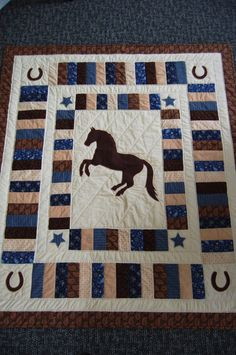 This quilt measures 47 X 53 and is made of 100% cotton fabrics. The horse, stars and horseshoes are machine appliquéd and the entire top of the quilt has been hand quilted. Finished with a cotton batting and a turned edge hand finished binding.  This quilt was made with the Lexington and Sturbridge collections from Moda. This quilt would make a wonderful lap quilt or wall hanging. If you would like to use this quilt as a wall hanging please let me know at time of purchase and I would be…