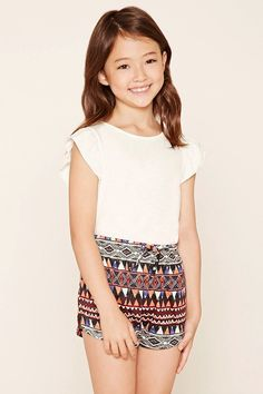 Forever 21 Girls - A pair of knit dolphin shorts featuring a tribal-inspired geo print, elasticized drawstring waist, and onseam pockets. #f21kids