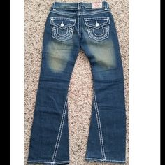 "True Religion White stitch flare Jeans True Religion size 26. dark blue with white stitching and ""tan fade"" authentic and in great condition. Only worn a couple times. True Religion Jeans Flare & Wide Leg"