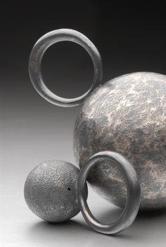 Oxidized silver Planet rings. Handmade by Malcolm Morris