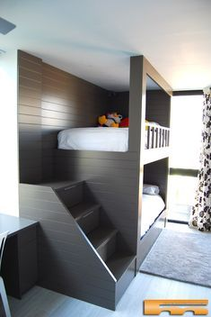 a dark stained ubnk bed unit with a staircase and wall lamps at the headboard of the bed - DigsDigs Bunk Bed Rooms, Bunk Beds With Stairs, Kids Bunk Beds, Small Room Bedroom, Bedroom Decor, Bedroom Ideas, Full Size Bunk Beds, Bed Unit, Bunk Bed Designs