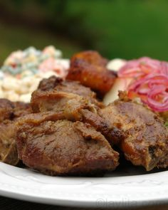 """Ecuadorian pork fritada is a popular weekend dish in Ecuador, in this traditional recipe the pork is cooked in a mix of water, orange juice with onion, garlic and cumin until the liquid is gone and the pork browns in the """"mapahuira"""" or mix of its own grease and spices/flavors from the onion/garlic."""