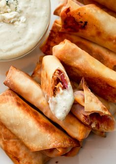 Buffalo Chicken Egg Rolls. Baked in an egg roll wrapper with shredded chicken, cabbage, cheddar or blue cheese and hot sauce