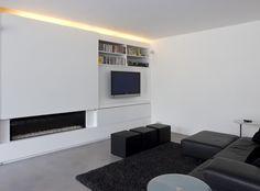 Welk ontwerp haardwand kiezen? - Wand boven haardvuur schuift over deel met tv. Ideaal dat je tv kan verstoppen!
