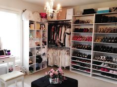 The closet is organized by colors.